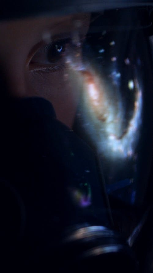 Galaxy Reflected on Astronaut Helmet