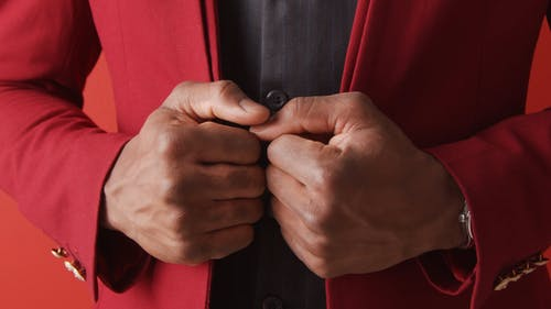 Person Wearing Red Suit