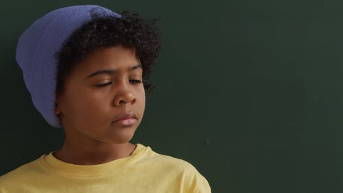 Video of a Boy Looking at Camera
