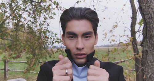 Close-up Video of a Man Looking at Camera