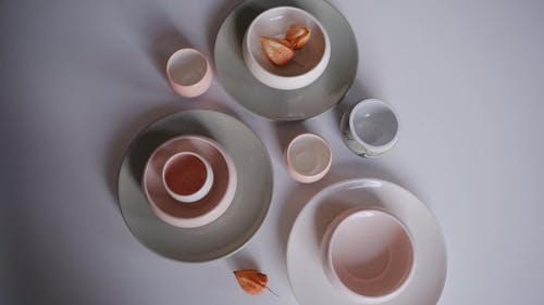 Ceramic Plates and Bowl on the White Table