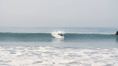 A Surfer Riding the Waves
