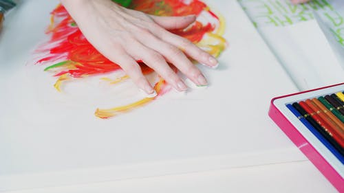 A Person Painting an Artwork