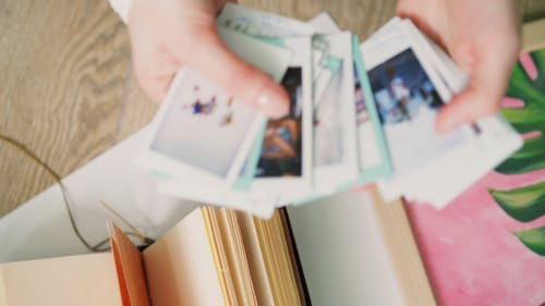 A Person Holding the Printed Photos