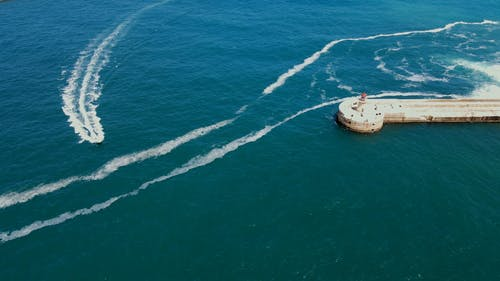 Drone Footage of a Boat Sailing on the Sea