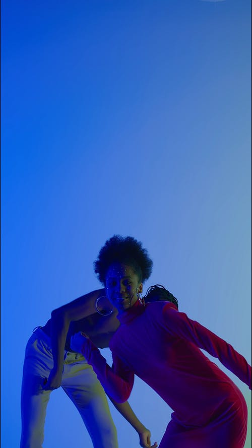 Man and Woman Dancing in Blue Background