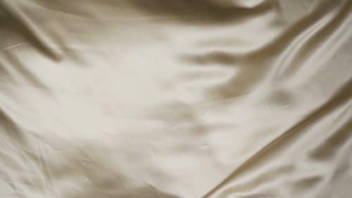 Close-Up Video of a Gold Silk Cloth