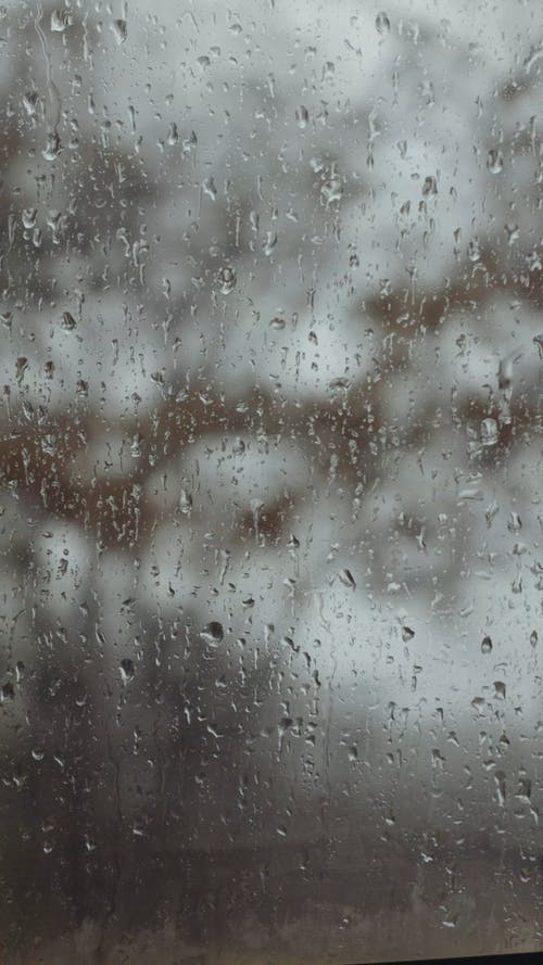 Water Droplets on a Glass Panel