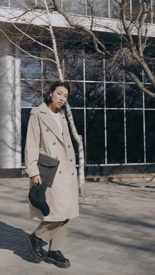 Elegant Young Woman Walking Outdoors
