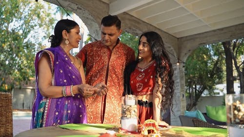 Indian Family Celebrating Diwali Festival with Fire Cracker