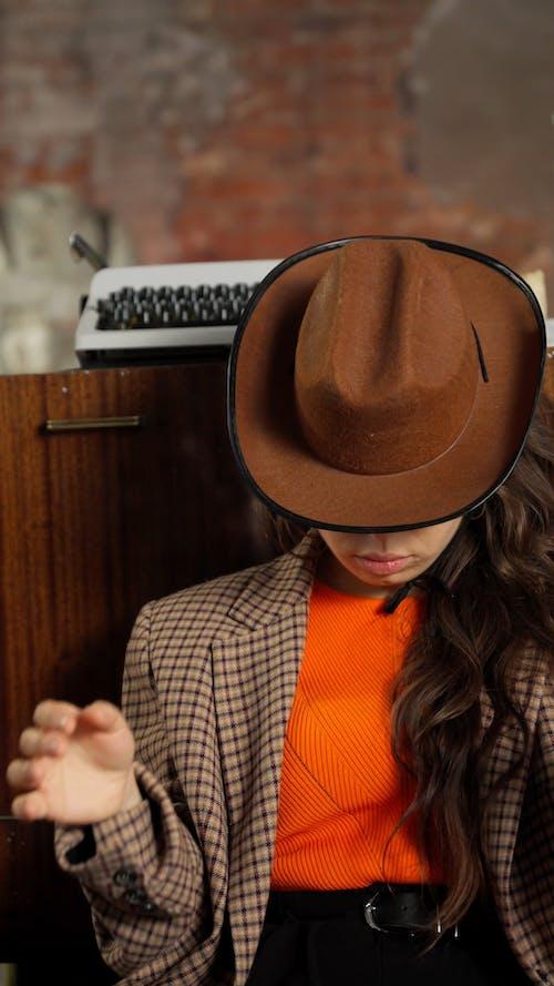 A Woman Wearing a Cowboy Hat
