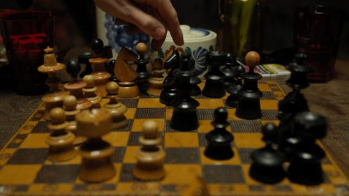 Close-Up View of People Playing Chess