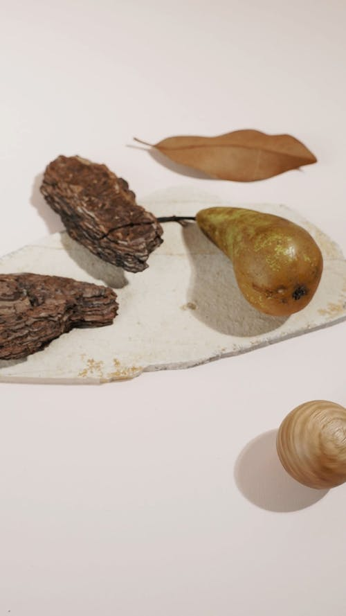 Brown Wood and Fruit on White Surface