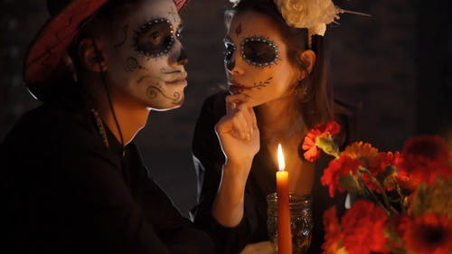 A Couple with a Muertos Face Painting