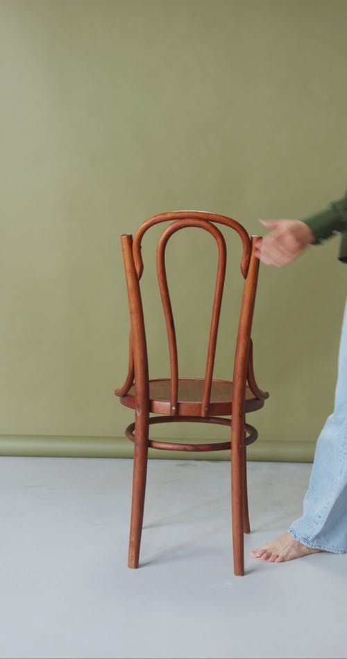 Woman Sitting on a Chair while Posing