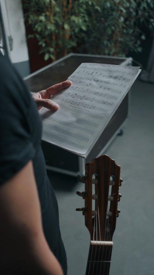 Musician Reading Sheet Music
