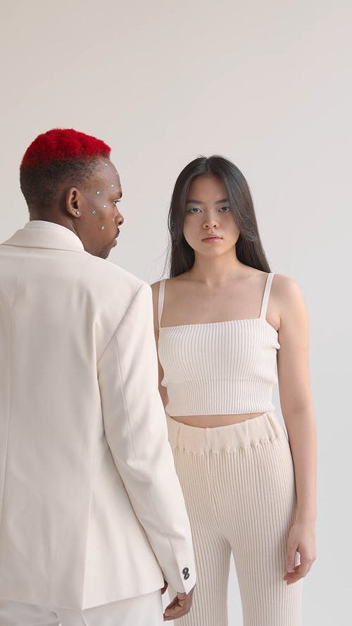 Man and Woman Wearing Beige Clothes in Studio