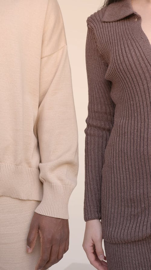 Couple wearing Beige and Brown Outfits
