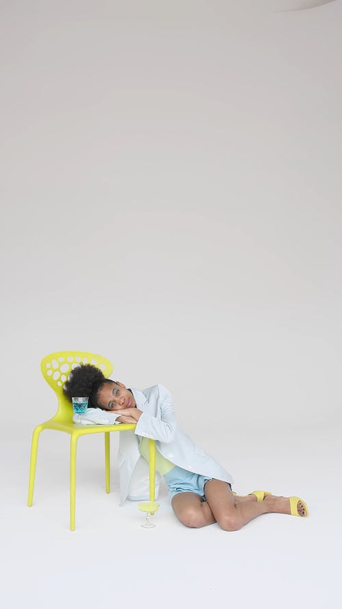 Young Woman Resting With Head on Chair