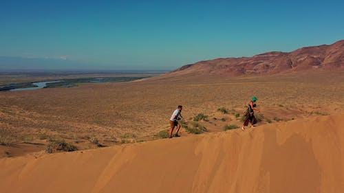 People Walking in Desert