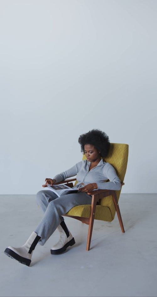 Woman Sitting While Reading