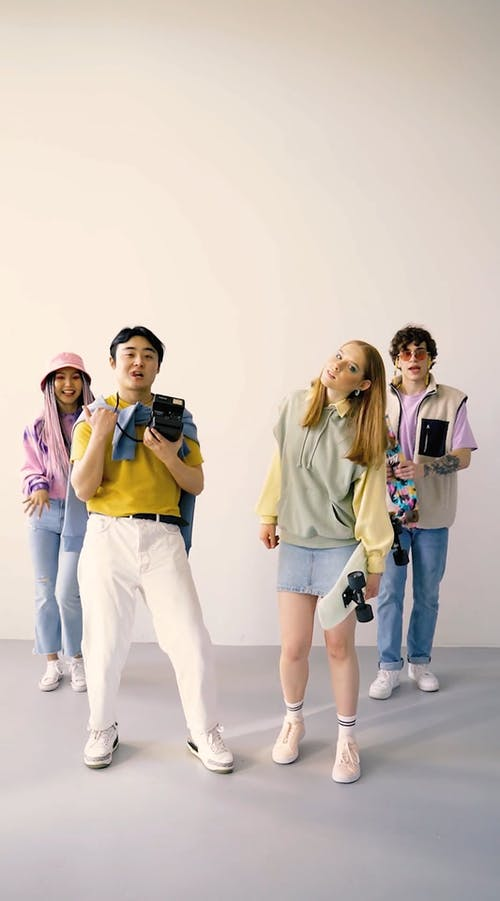 Models Dancing while Wearing Trendy Clothes