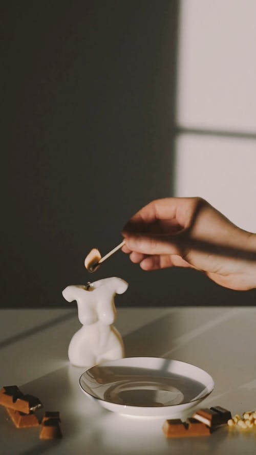 A Person Making a Chocolate and Milk Drink