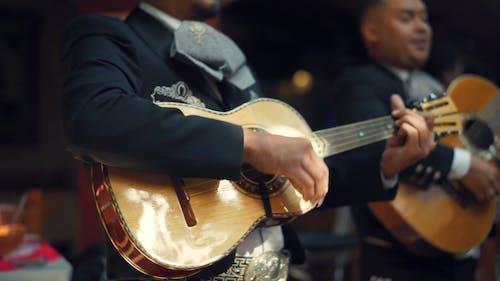 Guitarists Playing Music