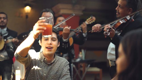 A Band Playing Music For Guests In A Restaurant