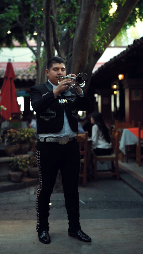 A Man Playing Music With A Trumpet