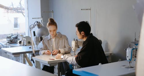A Woman Teaching How to Sew