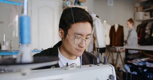 Male using Sewing Machine