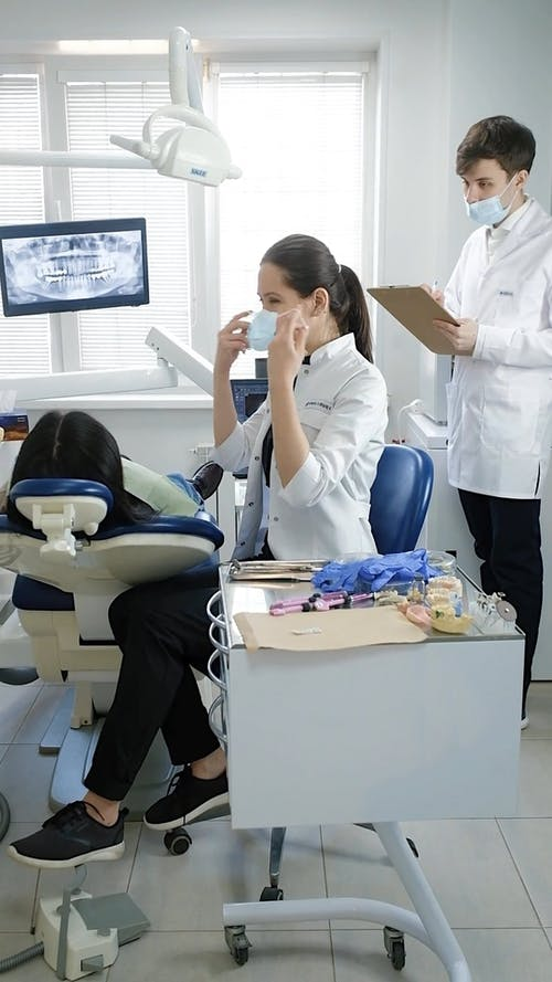 A Dentist Preparing for Her Patient