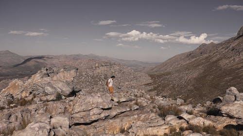 Man Hiking on a Rocky Mountain