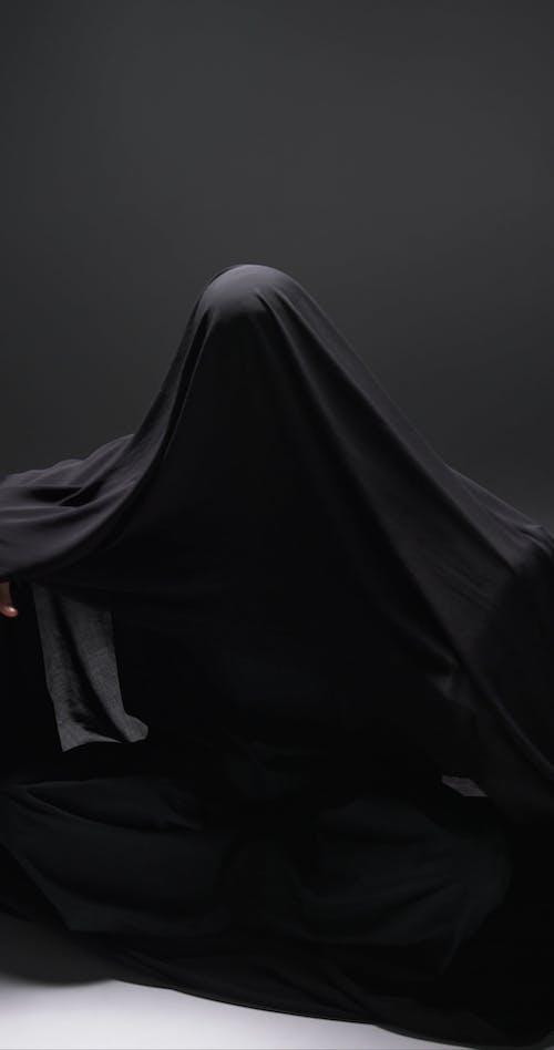A Woman Wearing An Abaya Dress