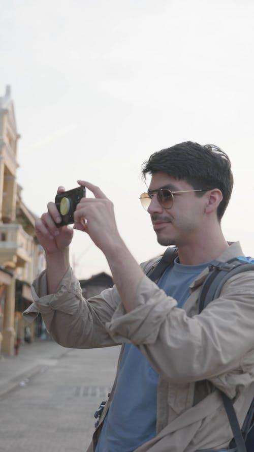Man Taking Photo Using a Smartphone