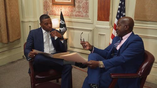 Two Men Talking in a Meeting