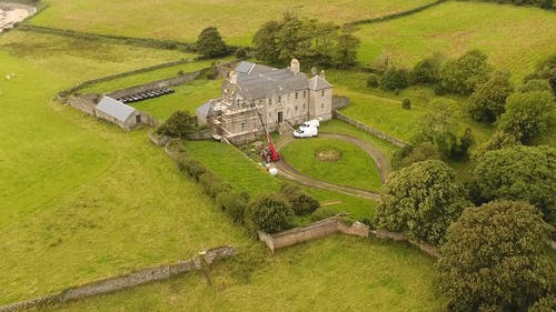 Aerial View of a House at the Fields