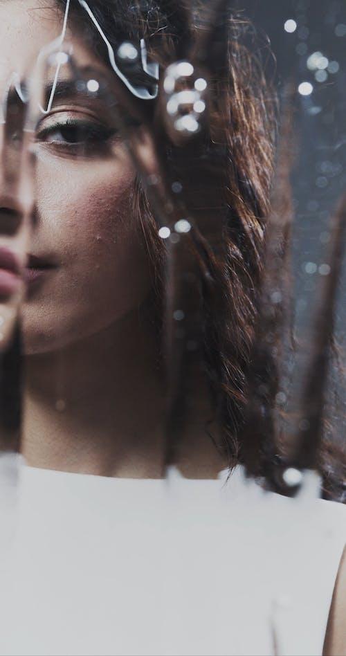 Woman Face Behind Irregular Glass Surface