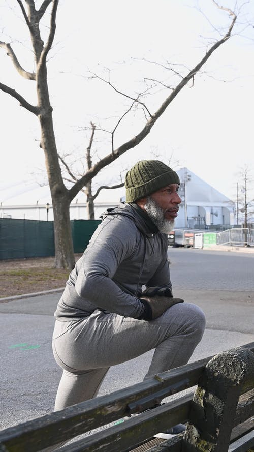 A Man Stretching His Knee