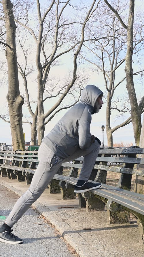 Man Stretching at the Bench