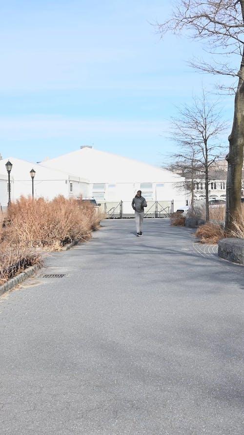An Elderly Man Jogging