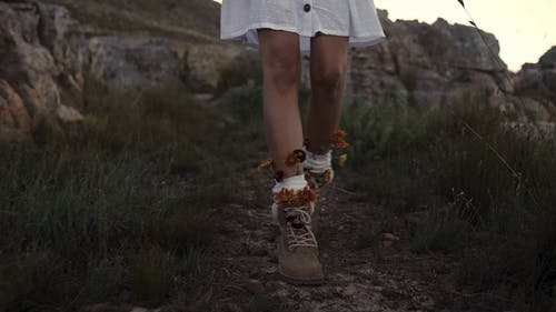 A Girl Walking with Flowers on Her Shoes
