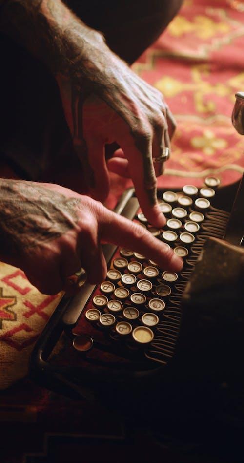 Video of Man Typing on a Vintage Typewriter