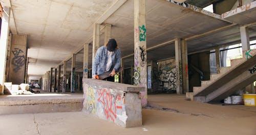 Man Waxing a Ledge for Skateboarding