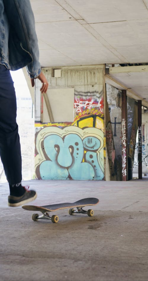 Male Grabbing and Riding a Skateboard