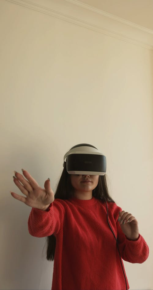 A Woman Wearing Virtual Reality Glasses