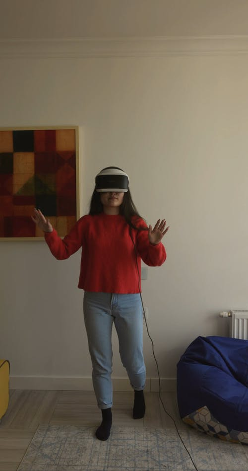 Woman Using a Virtual Headset at Home