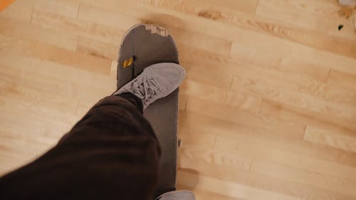 Crop Person Skateboarding Indoors