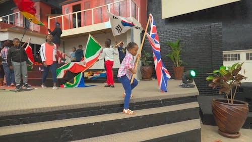 A Kids Holding a Flag